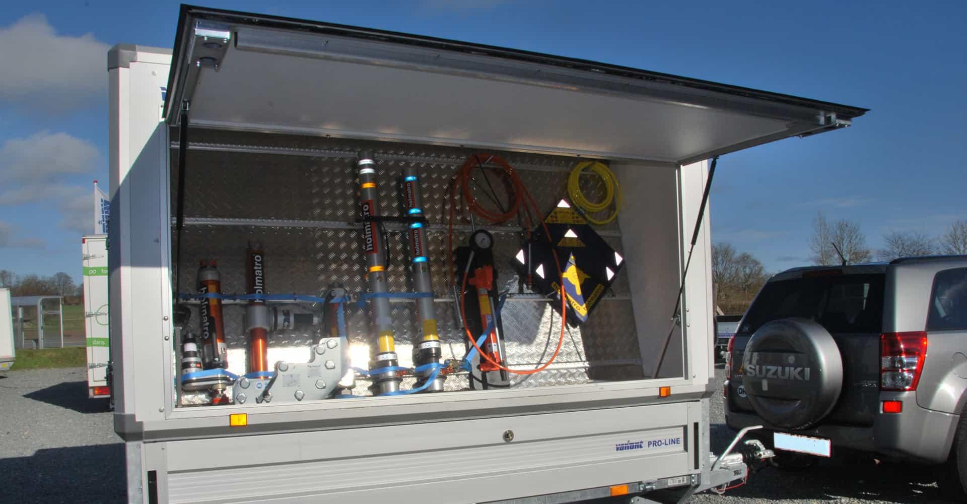Alsbilindretning med klapbar side med udstyr